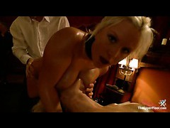 A gorgeous blonde gets her boobs abused at the kinky party