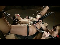 DragonLily gets her wet pussy spread with clamps for rough fisting