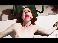 A slutty redhead gets dominated and punished by ebony nurse