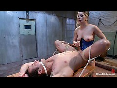 A male sub takes hot punishments and trials while bound on ice