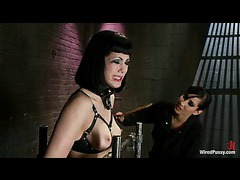 A dazzling brunette takes rough electro play in a body cage