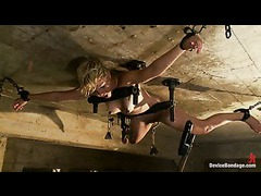 An adorable blonde fixed on the ceiling and abused with water
