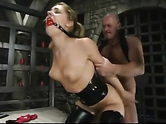 Blonde tied in leather clothes fucked deep in the mouth and then taken hard from behind