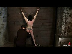 A busty babe bound to the wall in a back bend and flogged mercilessly