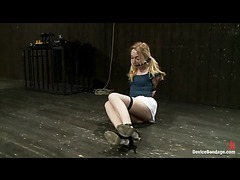 A petite slut squirming on electrical blocks with her wrists tied
