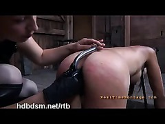 A restrained slut ordered to eat from the floor