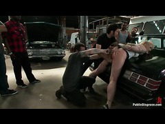 A blond whore shafted and fisted in an auto repair shop