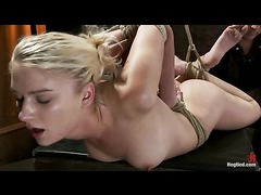 A shy blonde trembling in orgasmic spasms in a suspension