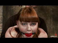 A cute redhead gets her nipples clamped and arms bound severely