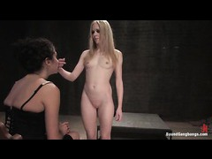 A suspended blonde gets her holes violated by masked men