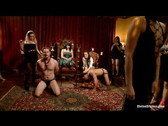 Bobbi Starr lets 40 women play with her male slave