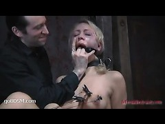 A restrained babe trades brutal suffering for orgasms