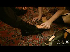 Heated slave girls lick and shine boots of their master