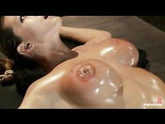 A big titted oiled up babe overloaded with brutal orgasms