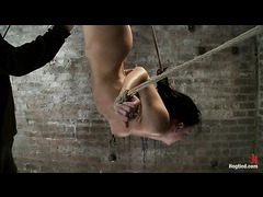 A hot slut arching back and cumming in an inverted suspension