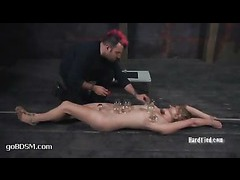 A sexy blonde struggles against tight knots of sophisticated bondage