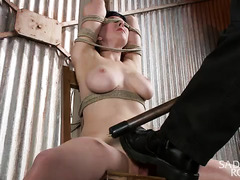 Suspended beauty receives rough and wicked torture for her succulent poon tang