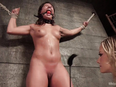 Young brunette is punished for engaging in blonde mistress lusty services
