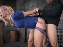 Gorgeous mature blonde slave services two demanding and horny male rods
