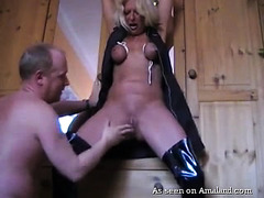 Tied up mature blonde chick's pussy is puffy from rough and zealous fisting