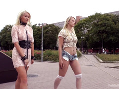 Two stunning blonde slaves are punished in public for being wanton whores