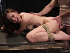 Horny brunette is punished for disturbing master while he was working