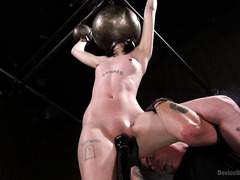 Skinny dark-haired beauty suffers under master's kinky and wild torture