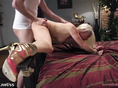 Sexy blonde chick receives rough drilling as she is bounded to the bed post
