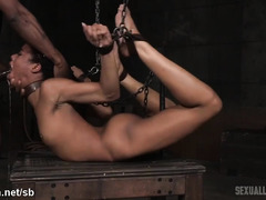 Sweet black darling gives amazing deepthroating delights while being chained up