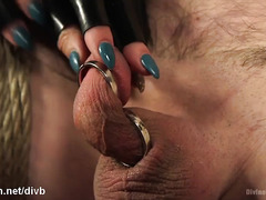 Blonde mistress shows submssive stud no mercy during bondage punishment
