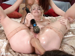 Busty mistress punishes two slaves with zealous anal drilling and fisting