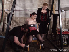 Submissive Caroline Pierces spanking and double domination of plastic tied bondage babe whipped and screaming in pain in the dungeon