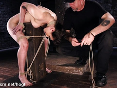Ferocious flogging punishment for gagged and bounded brunette slave
