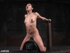 Petite slave is suffering from deepthroating and riding on the sybian machine
