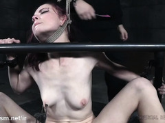 Inciting lusty screams from gorgeous redhead through whipping and flogging