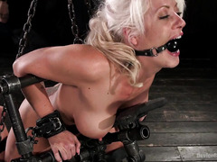 Big boobs blonde slave endures vigorous tormenting on her smoking hot body