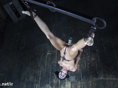 Submissive brunette slave squirms with pain from master's wicked electro play
