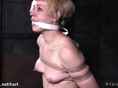 Tattooed blonde slave receives harsh whipping and explicit beaver toying