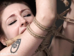 Tormenting sweet redhead slave with harsh flogging and whipping delights