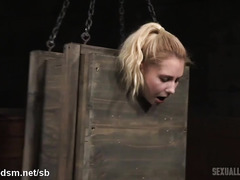 Boxed up blonde slave gives relentless deepthroating while receiving rough fucks
