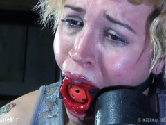 Beautiful blonde slave endures master's rough caning and paddling punishment