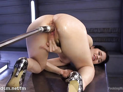 Dark-haired beauty plays with several fucking machines as she releases her urges