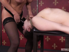Sweet slave has to endure rough beaver thrashing from busty mistress and master