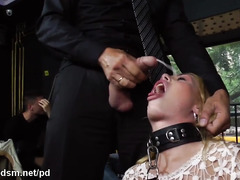 Captivating blonde slave enjoys wicked public humiliation in a busy cafe