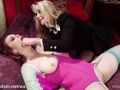 Redhead slave submits to mature blonde mistress's wild and rough demands