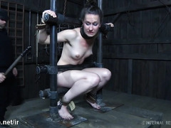 Chained up beauty submits to master's overpowering and lusty sexual tormenting