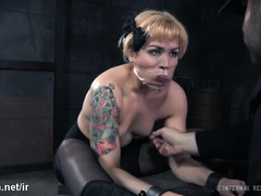Tattooed blonde endures harsh whipping for her sexy and rounded bottoms