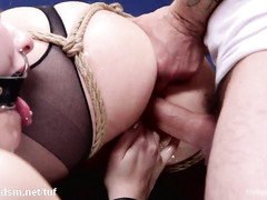 Brunette slave serves horny master and lusty blonde by being an obedient fuck toy