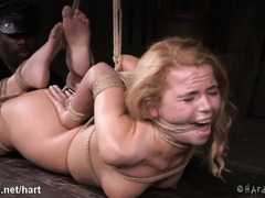 Black master tortures young brunette slave with harsh bondage and toying