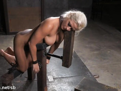 Busty blonde slave experiences vigorous hammering for her cunt and mouth